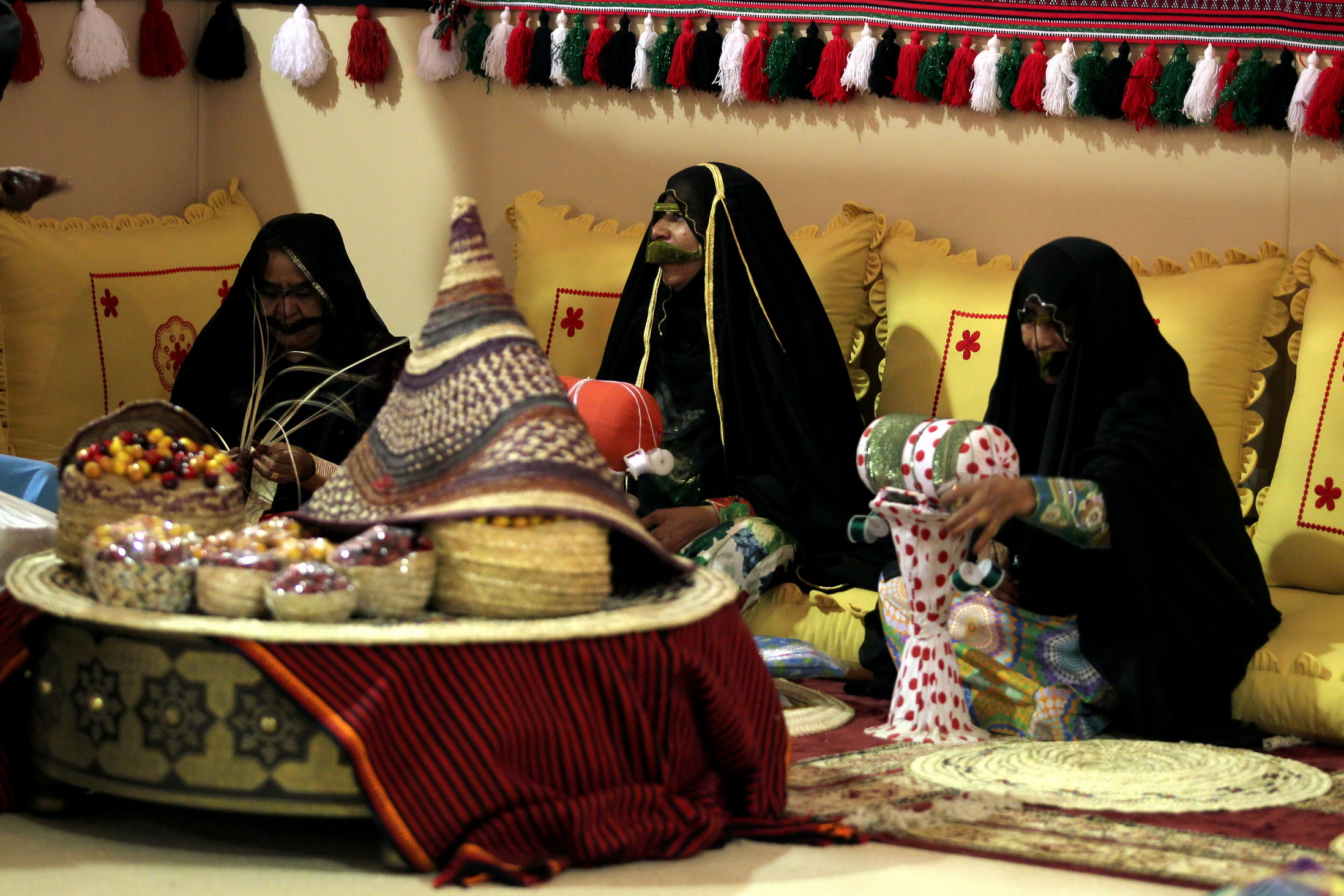 Bedouin solidarity and stories from the past woven through the 150 booths at the liwa dates festival's traditional market