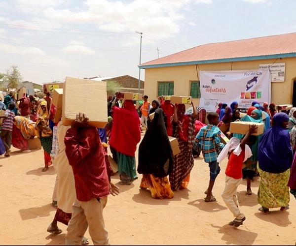 Aster Distributes 150,000 Salma Food Packets Among Famine Affected People in Somalia